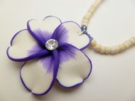 35mm flower w/ C.Z Stone in 2-3mm cream color Natural Coco bead