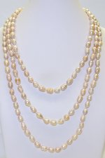 Peach Rice Shape 7-8mm Fresh Water Pearl Necklace 64""